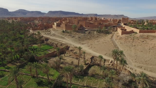 Drone footage of buildings in Erg Chebbi Desert
