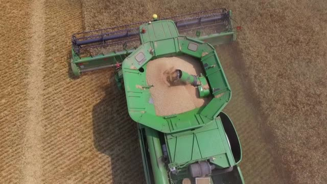 Drone footage of Deere Co combine harvesters as they harvest a field of wheat on a farm operated by Kernel Holding SA in Varva Ukraine on Tuesday...