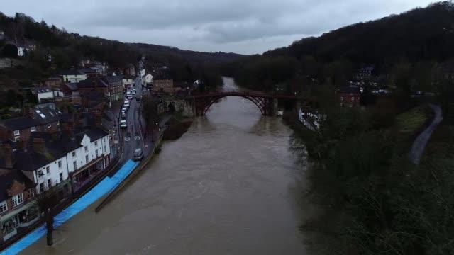 drone footage of flooding in ironbridge; england: shropshire: ironbridge: ext air views / aerials / drone footage river severn flooded around the... - ironbridge shropshire stock videos & royalty-free footage