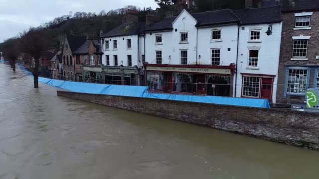 drone footage of flooding in ironbridge england shropshire ironbridge river severn flooded around the iron bridge / flood defences / flooding around... - canyon stock videos & royalty-free footage