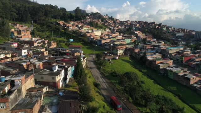 Drone footage of houses by street in city, Bogota, Colombia