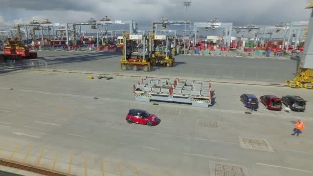 drone footage of london gateway docks drone aerials mini car at docks / drone aerials of london gateway docks cranes and containers - 自動車ブランド mini点の映像素材/bロール