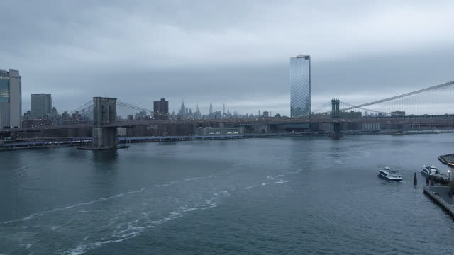 drone footage. of new york city on an overcast evening - international landmark stock videos & royalty-free footage