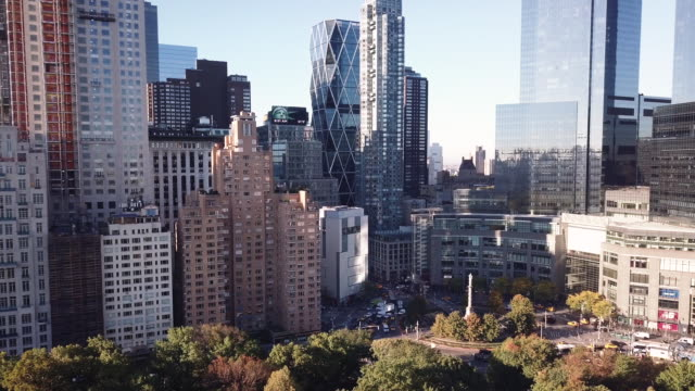 drone footage of new york city's columbus circle on a crisp autumn morning. - columbus circle stock videos & royalty-free footage