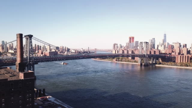 drone footage of new york's williamsburg bridge and east river. - williamsburg bridge stock videos and b-roll footage