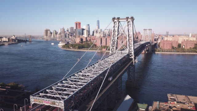 drone footage of new york's williamsburg bridge and east river. - williamsburg bridge stock videos & royalty-free footage