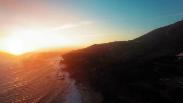 drone footage of rippling ocean surface and the shore at el matador beach, malibu, califronia, usa - malibu stock videos & royalty-free footage