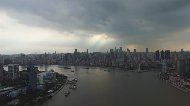 drone footage of shanghai showcases iconic shanghai skyline as seen from the huangpu river, and the bund opposite. buildings include oriental pearl... - river huangpu stock videos & royalty-free footage