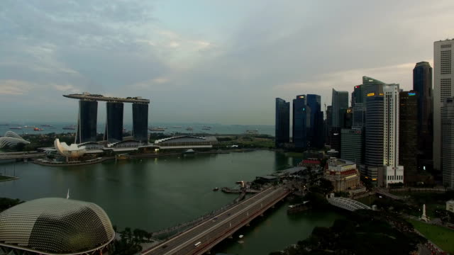 drone footage of singapore marina bay, esplanade theater and marina bay sands - marina bay sands stock videos and b-roll footage