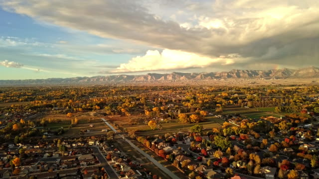 drone footage of stormy evening sunset with moody clouds over grand junction colorado - colorado stock videos & royalty-free footage