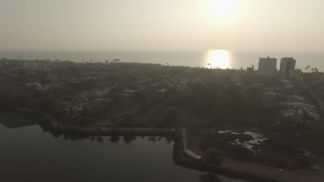 drone footage of sunset over lake coast and city buildings in colombo - sri lanka stock videos and b-roll footage