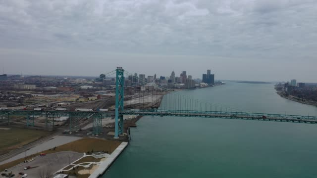 drone footage of the ambassador bridge shows almost empty streets during restrictive coronavirus measures on march 18, 2020 in detroit, michigan. - detroit michigan stock videos & royalty-free footage
