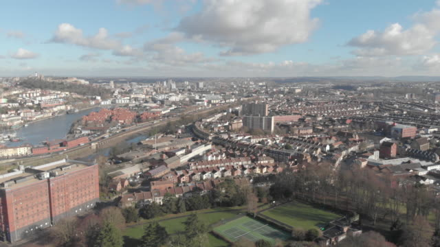 drone footage of the city of bristol, england, showing the avon river winding through the city center & harborside - bristol england stock videos & royalty-free footage