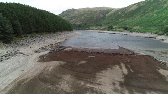 drone footage of the haweswater reservoir which is so low following a heatwave that traces of formerly submerged buildings can now be seen - northern europe stock videos & royalty-free footage