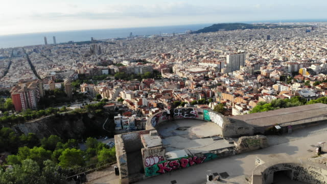 vidéos et rushes de drone footage of the military bunkers viewpoint over barcelona city during sunrise. - vertige