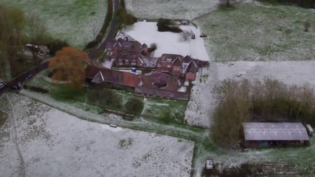 drone footage of the scene in bucklebury, berkshire, where thames valley police have launched a murder investigation after a man and a woman were... - berkshire england stock videos & royalty-free footage