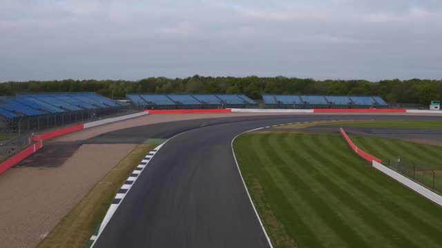 drone footage of the silverstone race track in buckinghamshire. next month's british grand prix will take place in front of a capacity 140,000 crowd,... - competition stock videos & royalty-free footage