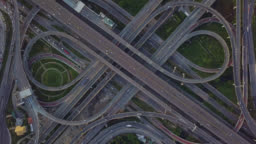 Drone footage of top view of Highway road junctions. The Intersecting freeway road overpass the eastern outer ring road of Bangkok, Thailand.Zoom out shot