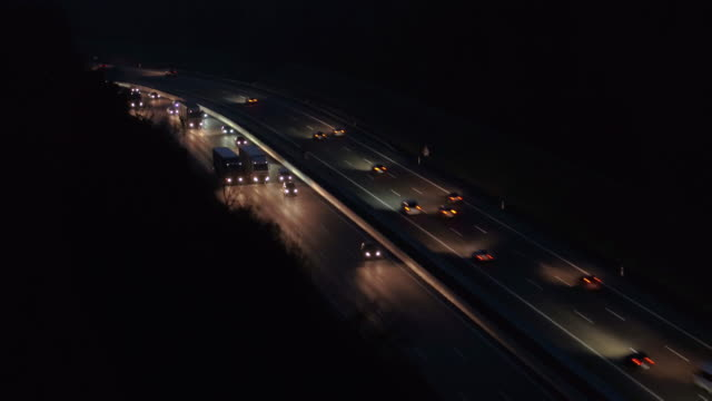 drone footage of vehicles moving on highway at night, baden-wuerttemberg, germany - motorway stock videos & royalty-free footage