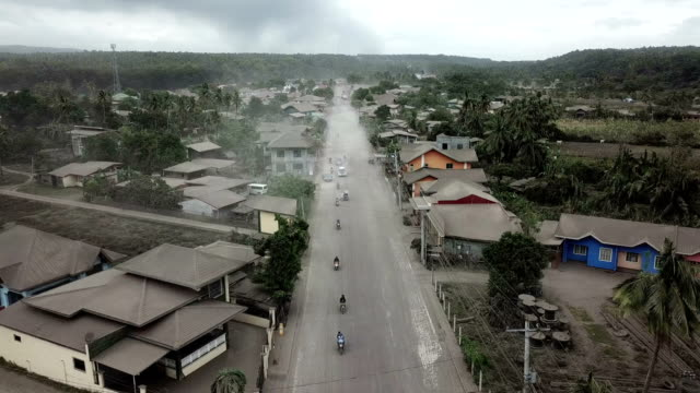 drone footage of volcanic ash covered road and town after taal volcano major eruption - taal volcano stock videos & royalty-free footage