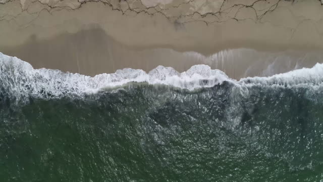drone footage of waves rolling on shore at beach, tayrona national park, colombia - tayrona national park stock videos and b-roll footage