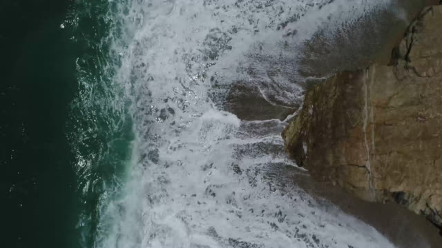 drone footage of waves splashing on rocks, tayrona national park, colombia - tayrona national park stock videos and b-roll footage