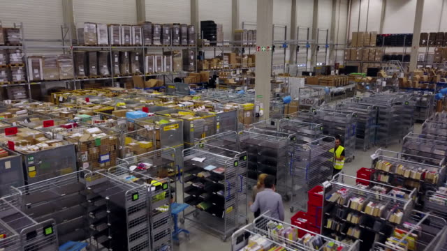 drone footage of workers in logistic center - warehouse stock videos and b-roll footage