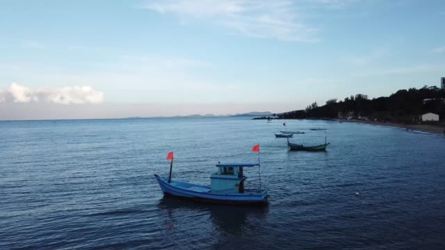 4k drone footage over fishing boats on phu quoc island, vietnam in the sunrise - vietnam meridionale video stock e b–roll