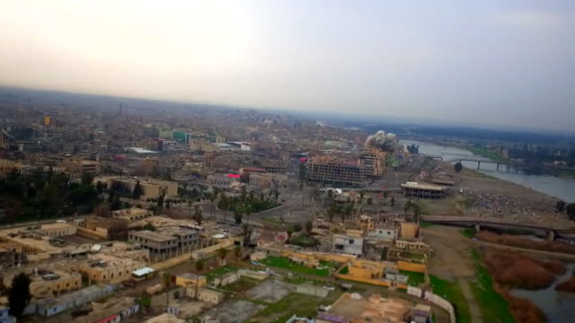drone footage over western mosul, showing explosions as iraqi army forces battle islamic state militants - iraq stock videos & royalty-free footage