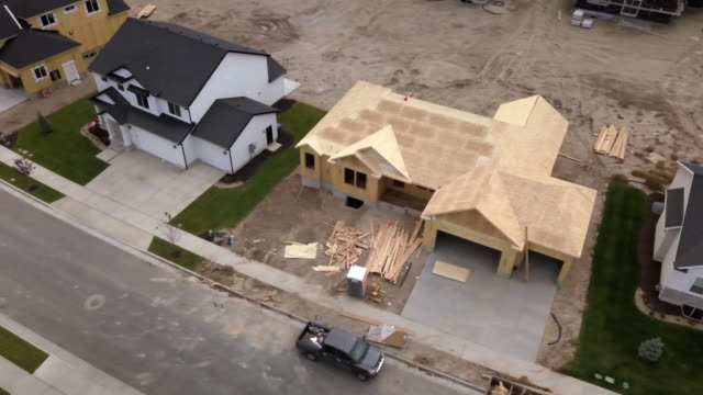 drone footage residential construction site - home ownership stock videos & royalty-free footage