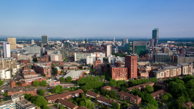 drone footage showing manchester skyline - manchester england stock videos & royalty-free footage
