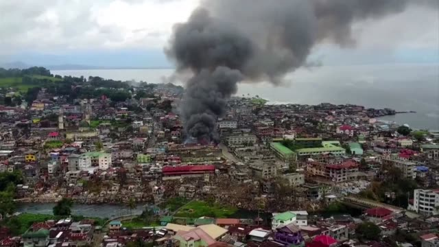 drone footage shows explosions and destroyed buildings in marawi where thirteen marines have been killed in fresh gunbattles with islamist militants... - philippines stock videos & royalty-free footage