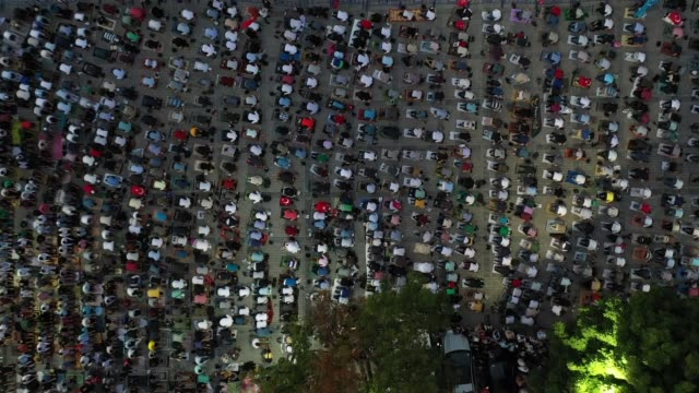 drone footage shows people gathered to perform the evening prayer at ayasofya square after the 10th chamber of the council of state's decision of the... - group of people stock videos & royalty-free footage