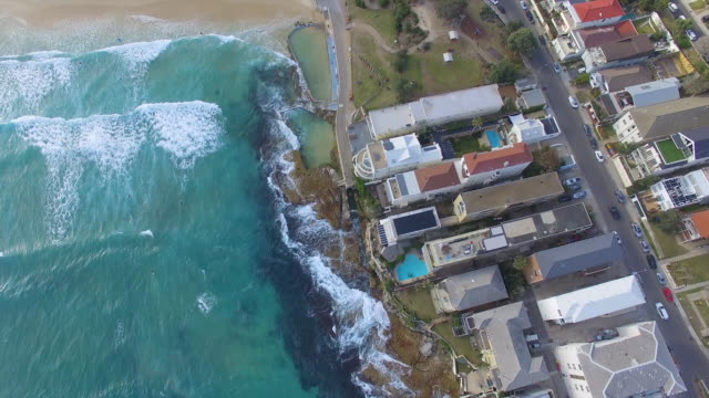 Drone gliding through Bondi beach capturing the waves