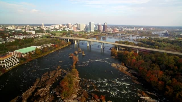 drone - high aerial of river and city downtown in autumn - richmond virginia stock videos & royalty-free footage
