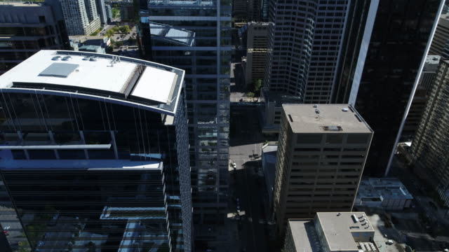 4k drone hovering in downtown calgary - calgary stock videos & royalty-free footage