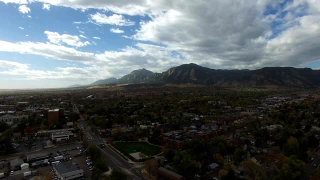 a drone hovers above boulder city colorado - colorado stock videos & royalty-free footage