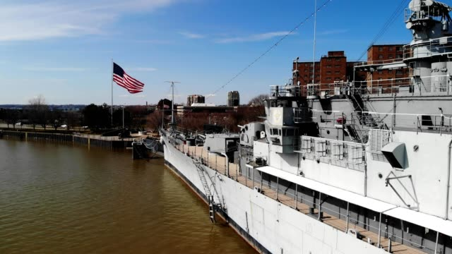 a drone hovers by a docked battleship in buffalo new york - buffalo new york state stock videos & royalty-free footage