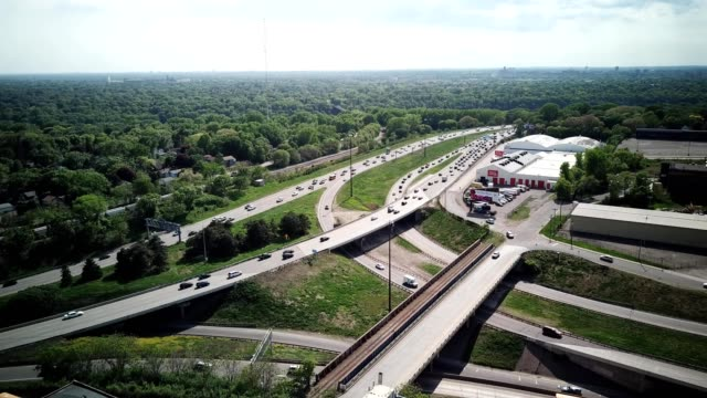 a drone hovers by i-94 raymond avenue intersection in saint paul minnesota - saint paul stock-videos und b-roll-filmmaterial