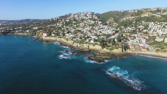 drone hovers high above the pacific ocean beach, aerial footage from laguna beach, california, usa - laguna beach california stock videos & royalty-free footage