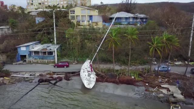 drone images thursday capture the extent of the damage in costa rica with boats pushed onto streets and highways completely flooded after hurricane... - folgen bewegungsaktivität stock-videos und b-roll-filmmaterial
