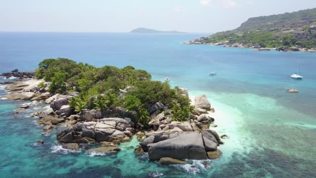 drone in seychelles on the beach - nature reserve stock videos & royalty-free footage