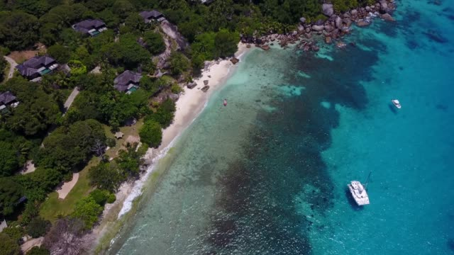 drone in seychelles on the beach - seychelles stock videos & royalty-free footage