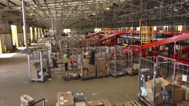 drone interiors package distribution warehouse - cardboard box stock videos & royalty-free footage