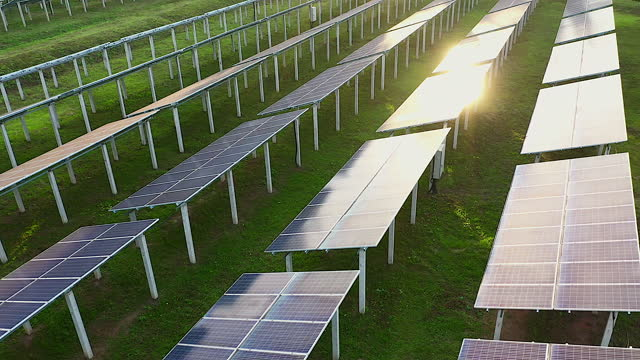 a drone is flying through a solar cell in the morning, with sunlight reflected on its body. solar cells are used in applications involving alternative energy. using solar energy to produce electricity. - energy efficient stock videos & royalty-free footage