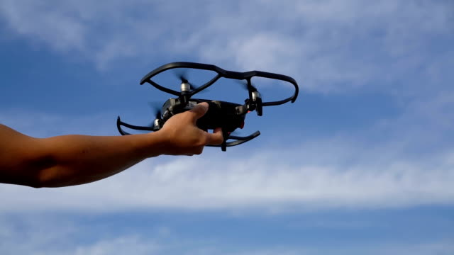drone landing on hand in  slow motion - film tilt stock videos & royalty-free footage