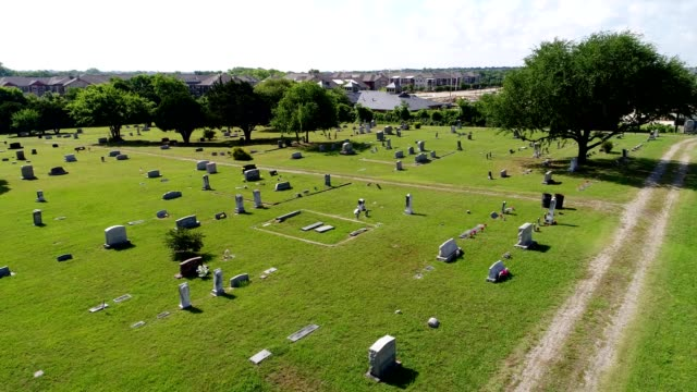 A drone low flies over a cemetery in Plano Texas