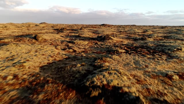 a drone low flies over a lava rock field in hella iceland - low stock videos and b-roll footage