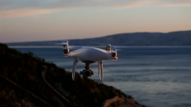 drone moving above rocky coastline - filming stock videos and b-roll footage