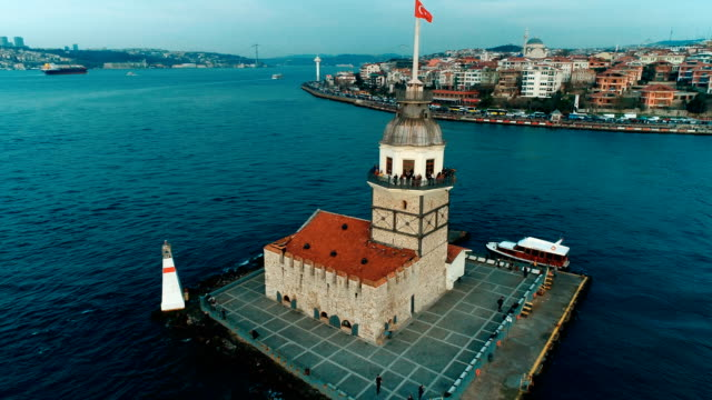 drone moving away from maiden's tower at sunset in istanbul - bosphorus stock videos & royalty-free footage